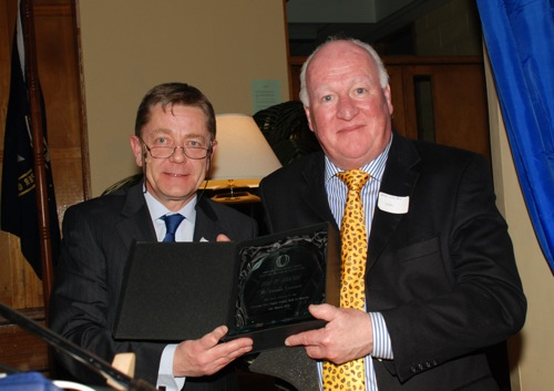 Dermot Cowhey presenting the Crescent Roll of Honour award to Brian Leonard on behalf of his late brother Denis Leonard