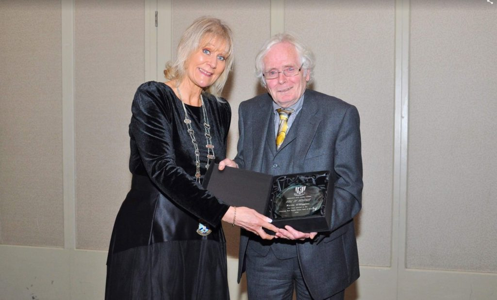 Kevin O'Higgins receives Roll of Honour award from President of the CCPPU Orla Prendergast